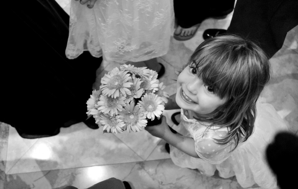 Little girl with a bouquet in a bridal procession
